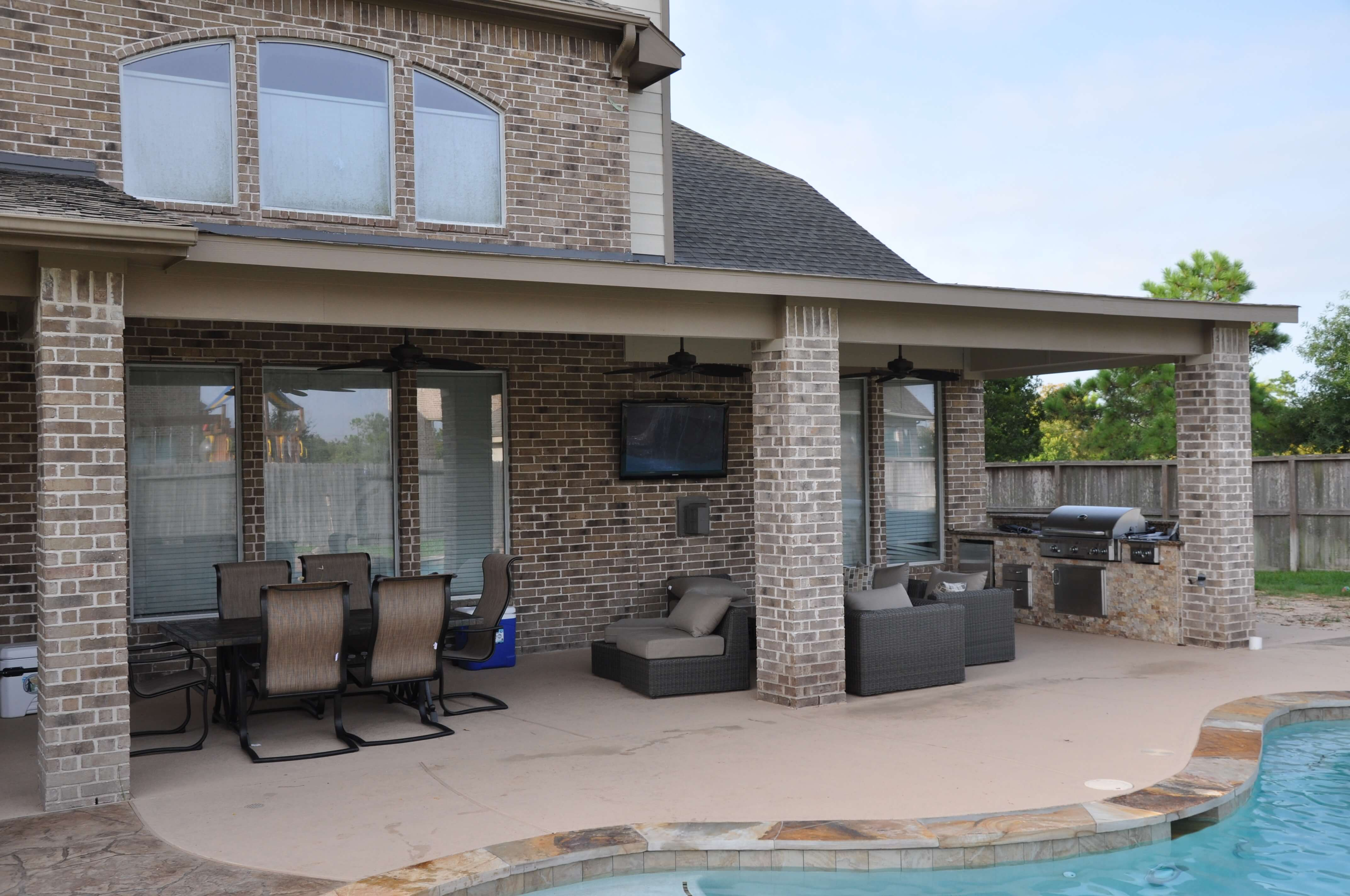 Pearland Outdoor Living Photos | League City Pool Builder on Outdoor Kitchen With Covered Patio id=63513