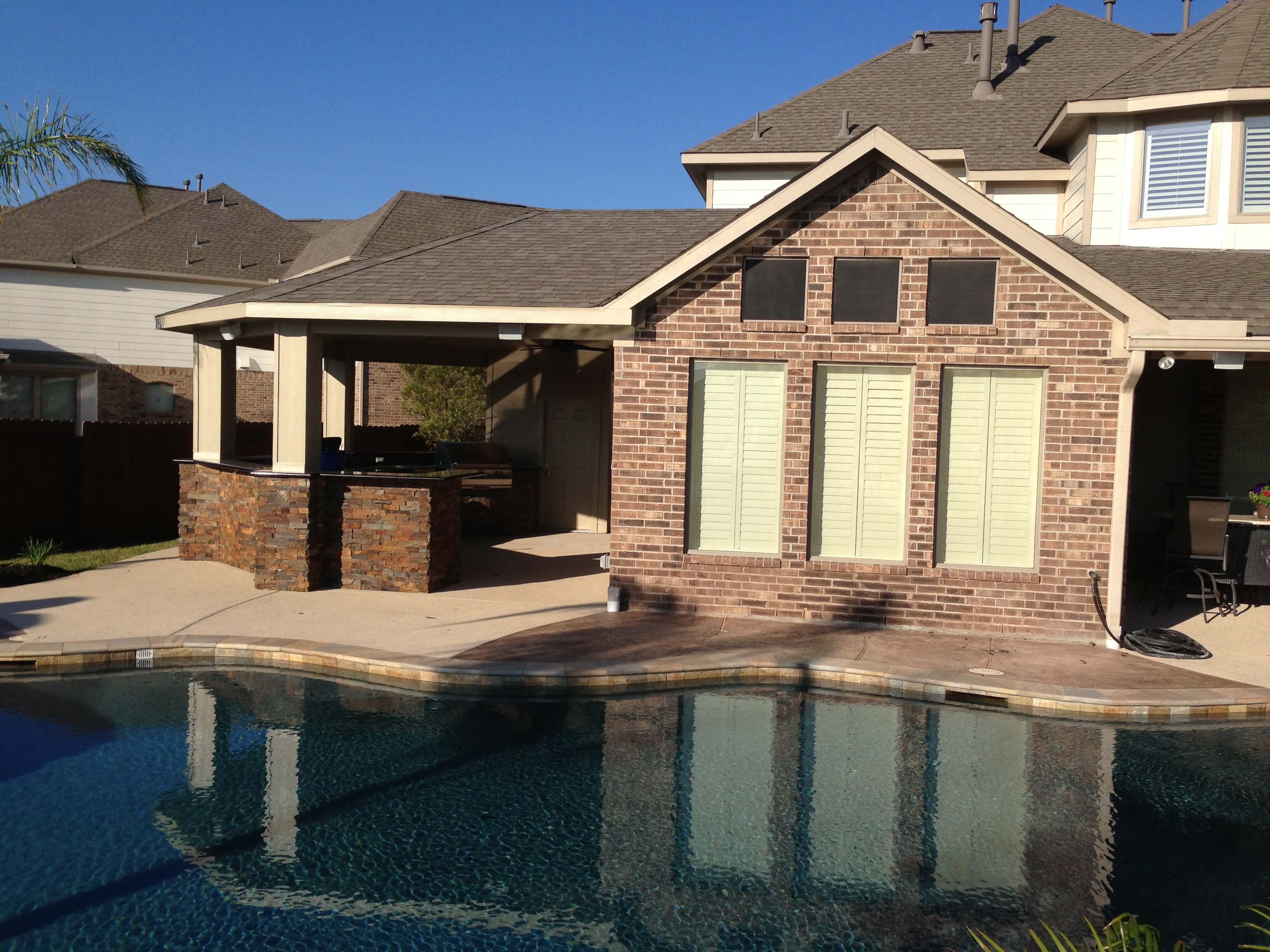 Pearland Outdoor Living Photos | League City Pool Builder on Outdoor Kitchen With Covered Patio id=38719